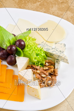 Cheese With Lettuce, Grapes And Nuts Closeup Stock Photo