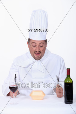 Chef Eating Fast-food And Drinking Wine Stock Photo