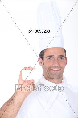 Chef With A Blank Business Card Stock Photo