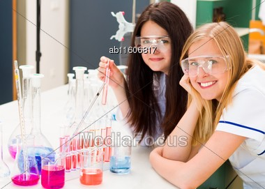 Chemists At The Lab With Experiment Of Protective Test Stock Photo