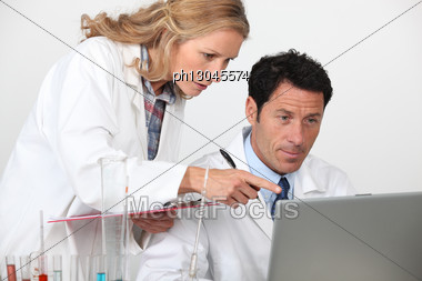 Chemists Looking At Laptop Stock Photo