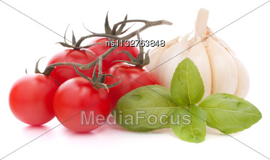 Cherry Tomato And Garlic Isolated On White Background Cutout Stock Photo
