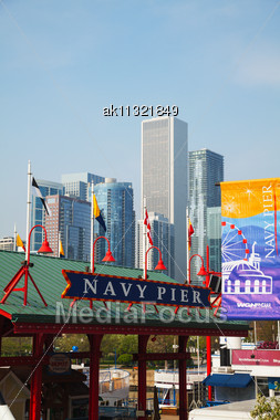 CHICAGO - MAY 19: Navy Pier On May 19, 2013 In Chicago, IL. It's Is A 3,300-foot (1,010 M) Long Pier On The Chicago Shoreline Of Lake Michigan. Navy Pier Is Chicago's Number One Tourist Attraction Stock Photo