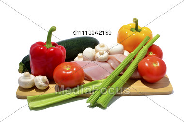 Chicken, Knife And Vegetables On A Cutting Board, Isolated On White Stock Photo