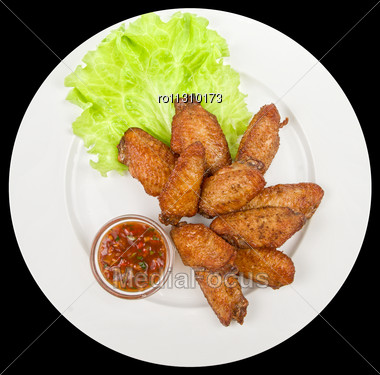 Chicken Roasted Wing Dish With Sauce On A Black Background Stock Photo