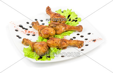 Chicken Wings Closeup At White Plate With Lettuce Stock Photo