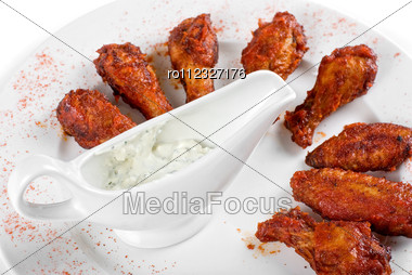 Chicken Wings With Sauce Closeup At White Plate Stock Photo