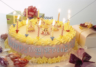 Birthday Cakes Gifts Images ~ Stock photo child birthday cake yellow frosting gifts image