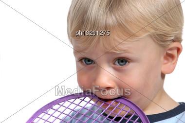 Child Biting Racket Stock Photo