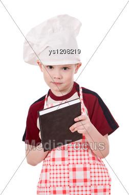 Child Chef Writing Something Stock Photo