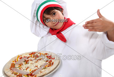 Child Dressed As Pizza Chef Stock Photo