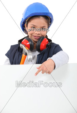 Child Dressed As A Construction Worker With A Board Left Blank For Your Message Stock Photo