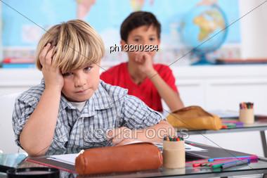 Child In School Bored Stock Photo