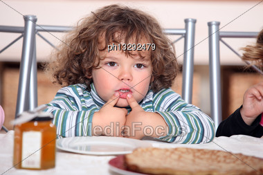 Child Looking Plate Of Pancakes Stock Photo