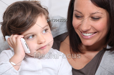 Child Playing With His Mother's Mobile Phone Stock Photo