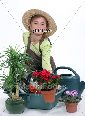 Child Pretending To Be A Florist Stock Photo