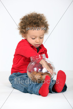 Child Taking A Cookie Stock Photo