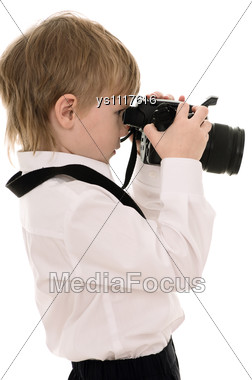 Child In A White Shirt With The Camera Stock Photo