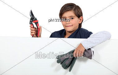 Child With Pruning Shears Stock Photo