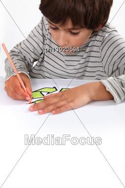 Child Working On His Homework Stock Photo