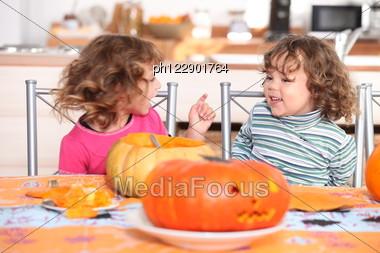 Children Carving Pumpkins Stock Photo