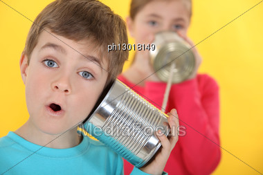 Children Communicating With Tin Cans Stock Photo