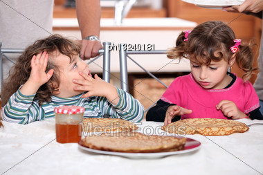 Children Eating Pancakes Stock Photo