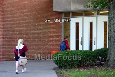 Children Entering School Stock Photo