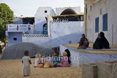Children Playing Outside Her House In A Nubian Village Stock Photo