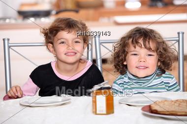 Children Snacking Stock Photo