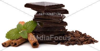 Chocolate Bars Stack And Cinnamon Sticks Isolated On White Background Stock Photo