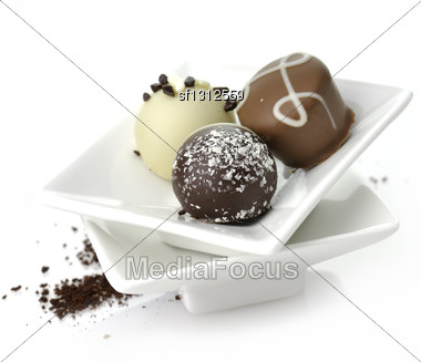 Chocolate Candies Assortment In A White Dish Stock Photo