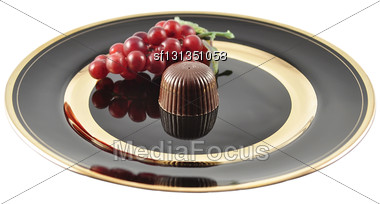 Chocolate Candy On A Black Plate On White Background Stock Photo