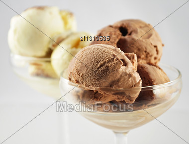Chocolate And Vanilla Ice Cream In Glass Dishes, Close Up Stock Photo