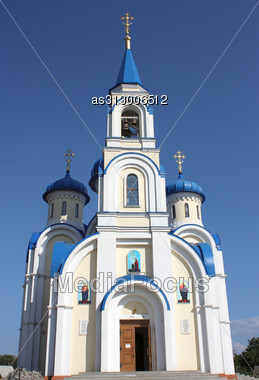 Christian Church With Dark Blue Domes Of White Color Against The Dark Blue Sky Stock Photo