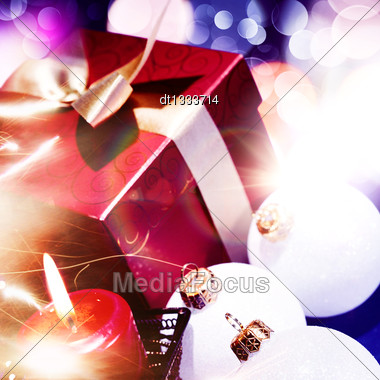 Christmas Background With Candle And Decorations On Blue Stock Photo