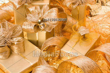 Christmas Background. Shiny Gifts Stock Photo