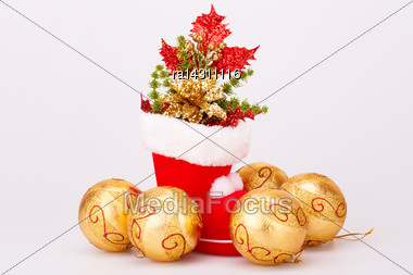 Christmas Balls And Santa's Red Boot With Decoration Isolated On Gray Background Stock Photo