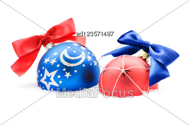 Christmas Balls With Bow In Snow Stock Photo
