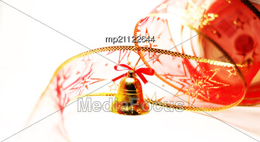 Christmas Bell Toy With Red Ribbon On White Stock Photo