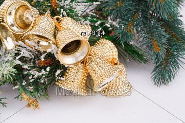 Christmas Bells And Fir-tree Branch On Gray Background Stock Photo