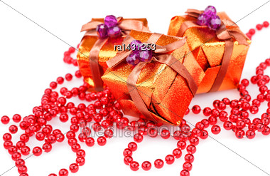 Christmas Boxes And Beads Isolated On White Background Stock Photo