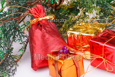Christmas Boxes And Fir Tree Branches On Gray Background Stock Photo