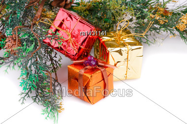 Christmas Boxes And Fir Tree Branches On White Background Stock Photo