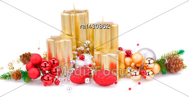 Christmas Candles, Balls And Fir Tree Branches Isolated On White Background Stock Photo
