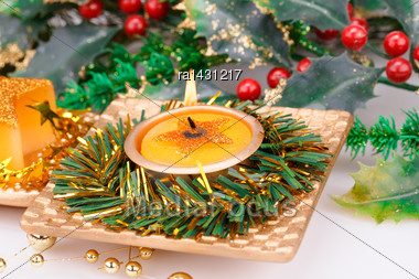 Christmas Candles And Decoration On Gray Background Stock Photo