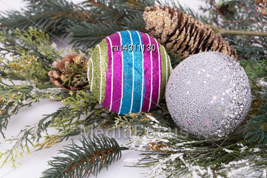 Christmas Colorful Balls, Cones, Fir-tree Branch On Gray Background Stock Photo