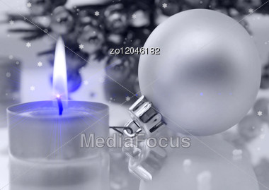Christmas Decoration A Candle And A Fur Tree Sphere Stock Photo