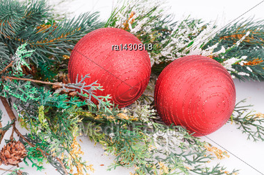 Christmas Decoration With Red Balls And Fir-tree Branch Stock Photo