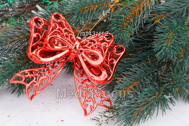 Christmas Decoration With Red Ribbon And Fir-tree Branch Stock Photo